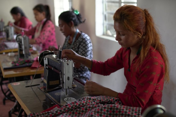 Marginal women are learning tailoring skills in training center (2)