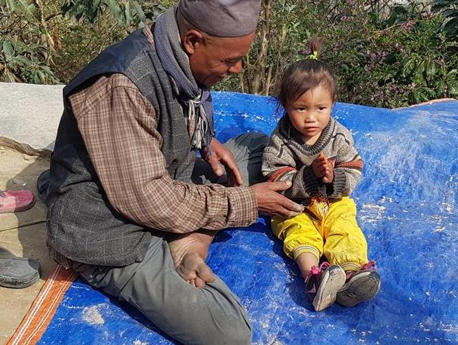 Grandpa and granddaughter in Nepal OHF
