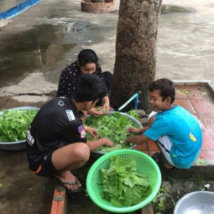 HVPV children washing vegetables together with house parents