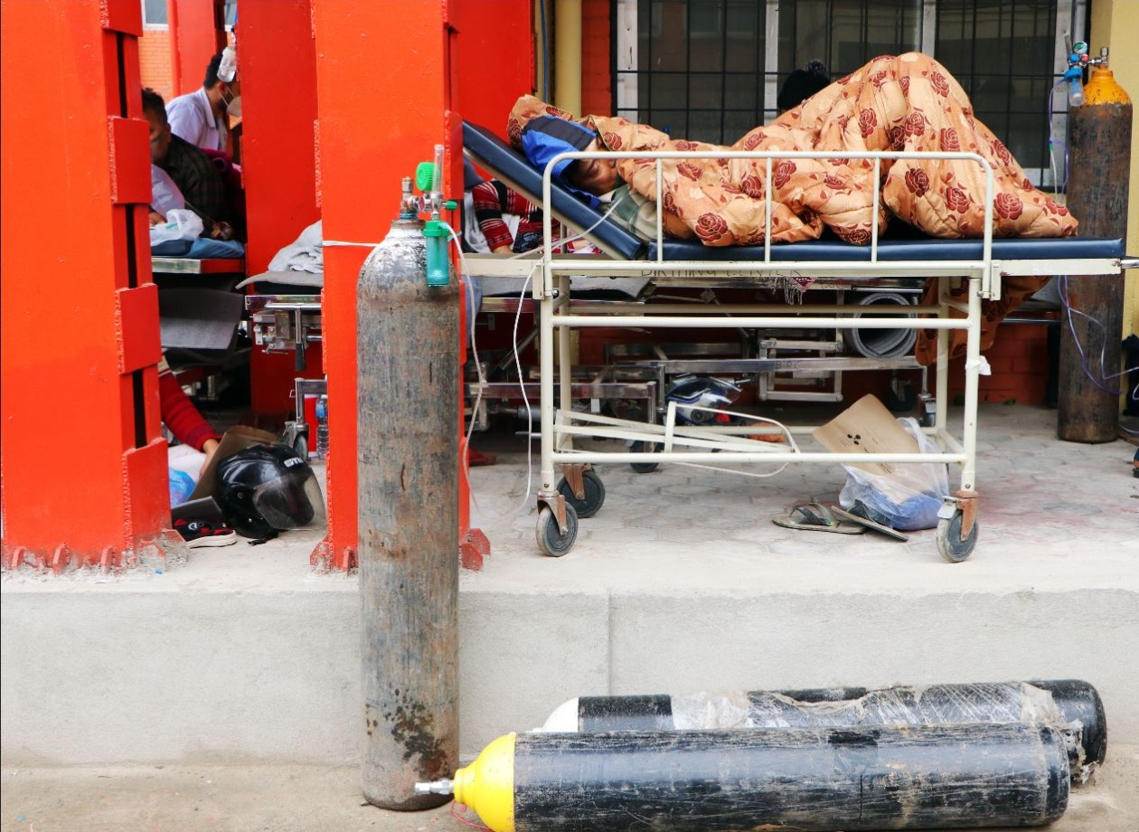 [Compressed] Empty oxygen cylinders on street beside Covid patient, Kathmandu 12 May