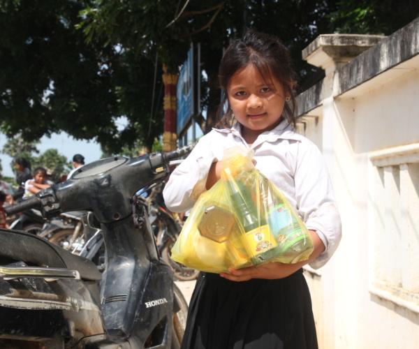 Cambodian Girl At NRCS Food Pack Distribution
