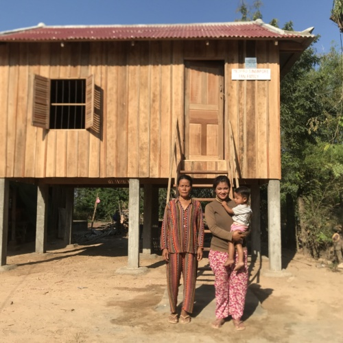 Beneficiaries and their new wooden house
