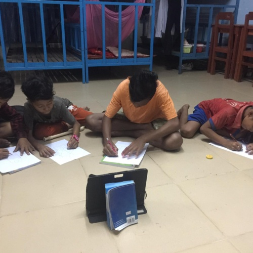 HVPV Boys Drawing in front of Tablet